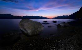 Large Rock Along Lake shore At Night Stock Photos