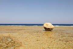Large rock on beach stock image
