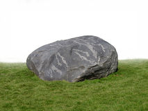 Large rock boulder on grass . Large gray granite boulder sitting on grass  on white Royalty Free Stock Photography
