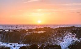 Waves crash against the rocks of tide pools on the California Coast Stock Photos