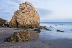 Large rock at El Matador Beach, Malibu. A large rock dominates the beach at El Matador State Park in Malibu, California, shortly after sunset Stock Image