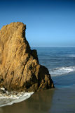 Large Rock formation on Beach. Large rock formation by the ocean Royalty Free Stock Photos