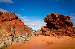 Large rock formations on sandy beach at Port Macquarie Australia Stock Image