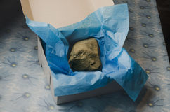 Large rock in gift box Royalty Free Stock Image