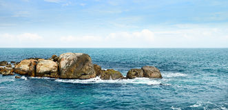 Large rock in ocean Royalty Free Stock Image