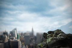 Large rock overlooking big city Royalty Free Stock Images