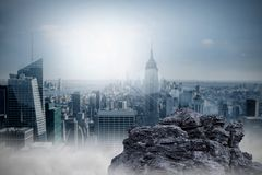 Large rock overlooking big city Stock Photo
