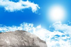 Large rock overlooking blue sky Royalty Free Stock Image