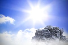 Large rock overlooking bright sky Royalty Free Stock Photos