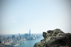 Large rock overlooking coastline city Royalty Free Stock Photos