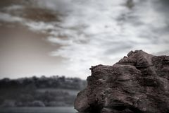 Large rock overlooking foggy forest Royalty Free Stock Photo