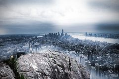 Large rock overlooking huge city Stock Photo