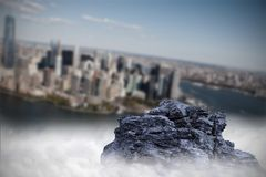 Large rock overlooking island city Stock Image