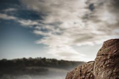 Large rock overlooking vast forest. Digitally generated large rock overlooking vast forest Stock Photography