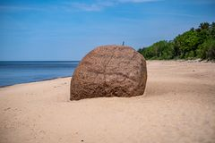 Large rock in sand. In countryside, isolated stone royalty free stock image