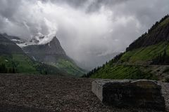 Large Rock On The Side Of Going To The Sun Road. Overlooking the valley stock photo
