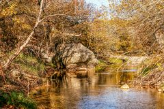 Large Rock in a Stream. In Arbucklr Mountains in central Oklahoma Stock Photography
