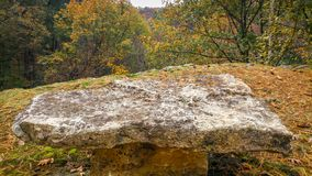 Large Rock Table Sitting on A Ledge with Overlook. A very large rock made into a table, sitting on a ledge with an amazing overlook in the Baraboo, Wisconsin stock photography