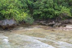 Large rocks beach. Large rocks on the shore of the bohol Philippine sea stock image