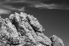 Large Rocks and Boulders against Sky Stock Photo