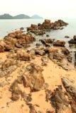 Large rocks coastline with waves crashing sea. Stock Photos