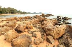 Large rocks coastline with waves crashing sea. Royalty Free Stock Photo