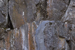 Large Rocks With Colorful Lichen Streaks Stock Photos