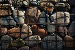 Large Rocks Contained in a Wire Cage Royalty Free Stock Photography