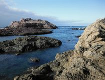 Large Rocks in the Ocean. Cayucos, California stock photo