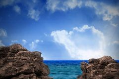 Large rocks overlooking sea and sky Royalty Free Stock Photos