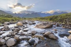 Large rocks in the river. Drakensberg South Africa stock photography