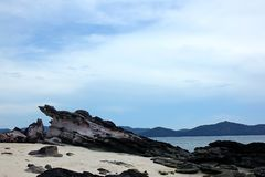 Rocks on the beach in the sea. Large rocks on the sand along the length of the beach Royalty Free Stock Image