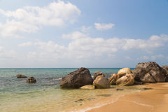 Large rocks on the sandy beach Stock Photography