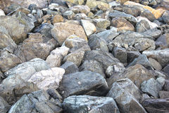 Large rocks on the sea shore. Seascape  on winter day Royalty Free Stock Photography