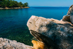 Large rocks on sea. Large rocks on turquoise sea water Stock Photography