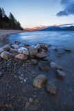 Large rocks on shore. Large rocks in the foreground of a landscape image on  Pend Oreille Lake in Idaho Stock Photos
