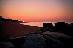 Large rocks on the shore of the Mediterranean Sea at the magnificent sunrise in Malgrat de Mar in Spain. Sunrise over the coast of Costa del Maresme. Rocks Royalty Free Stock Images