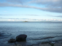 Large rocks on the shore of the White Sea. Rocks on the shore of the White Sea Royalty Free Stock Photo