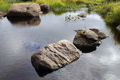 Large rocks in a small river Stock Photo