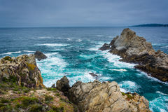 Large rocks and waves in the Pacific Ocean, seen from a beach at Royalty Free Stock Image