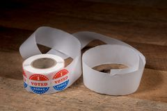 Roll of I Voted Today paper stickers on rustic wooden table stock photos