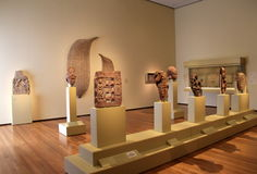 Large room with Egyptian artifacts set on pedestals, Cleveland Art Museum, Ohio, 2016. Beautiful image of large, airy room and exhibit of Egyptian artifacts set stock image