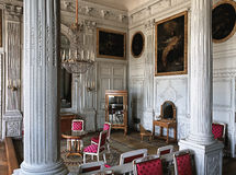 Large room with wooden wall and paintings at Versailles Palace royalty free stock photography