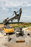 Large rotary drill and excavator on construction site Stock Photography