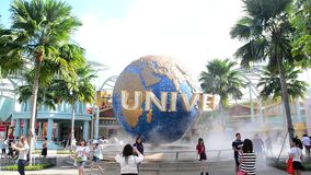 The large rotating globe fountain in front of Universal Studios on January 13, 2015 in Sentosa island, Singapore. SINGAPORE - JANUARY 13 Tourists and theme park stock video