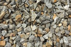 Large rough gravel stone texture background.  Stock Image