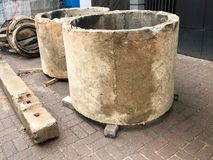 Large round concrete cement stone circles rings wells at a construction site royalty free stock image