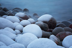 Large round icy stones Royalty Free Stock Image