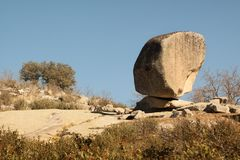 Large round stone monolith in nature. Surreal landscape, obstacles on the road royalty free stock photo