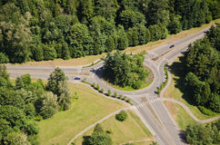 Large Roundabout - Aerial. Two cars approach roundabout from opposite sides Royalty Free Stock Photography